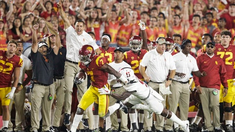 Southern California running back Stephen Carr, center left, carries the ball under defense by Stanford safety Ben Edwards during the second half of an NCAA college football game, Saturday, Sept. 9, 2017, in Los Angeles. (AP Photo/Jae C. Hong)