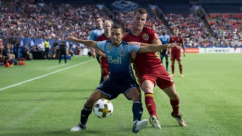 Vancouver Whitecaps' Nicolas Mezquida, left, and Real Salt Lake's Brooks Lennon vie for the ball during the second half of an MLS soccer match Saturday, Sept. 9, 2017, in Vancouver, British Columbia. (Darryl Dyck/The Canadian Press via AP)