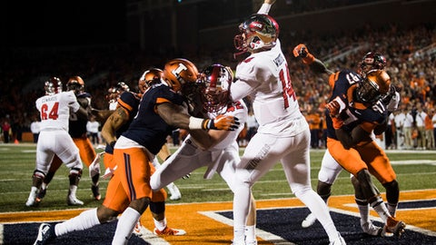 Western Kentucky quarterback Mike White (14) throws an interception as he is pressured by Illinois in his own end zone during an NCAA college football game Saturday, Sept. 9, 2017, in Champaign, Ill. (Austin Anthony/Daily News via AP)