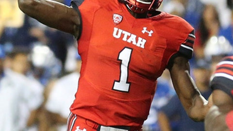 Utah quarterback Tyler Huntley throws a pass against BYU during the first half of an NCAA college football game Saturday, Sept. 9, 2017, in Provo, Utah. (AP Photo/Rick Bowmer)
