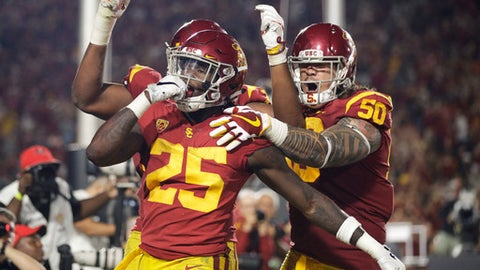 Southern California running back Ronald Jones II, center, celebrates his touchdown with Toa Lobendahn, right, and Chuma Edoga during the second half of an NCAA college football game against Stanford, Saturday, Sept. 9, 2017, in Los Angeles. (AP Photo/Jae C. Hong)
