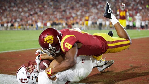 Stanford wide receiver JJ Arcega-Whiteside, bottom, catches a touchdown while defended by Southern California cornerback Iman Marshall during the second half of an NCAA college football game, Saturday, Sept. 9, 2017, in Los Angeles. (AP Photo/Jae C. Hong)