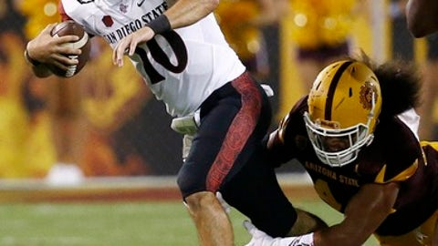 San Diego State quarterback Christian Chapman (10) gets sacked by Arizona State's Alani Latu, right, during the first half of an NCAA college football game Saturday, Sept. 9, 2017, in Tempe, Ariz. (AP Photo/Ross D. Franklin)
