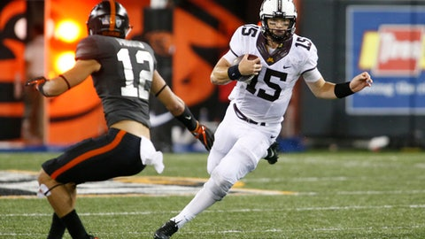 Minnesota quarterback Conor Rhoda (15) tries to get past Oregon State's David Morris during the second half of an NCAA college football game, in Corvallis, Ore., Saturday, Sept. 9, 2017. Minnesota won 48-14. (AP Photo/Timothy J. Gonzalez)