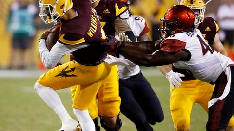 Arizona State's Manny Wilkins, left, gets pulled down by San Diego State's Jay Henderson, right, during the second half of an NCAA college football game Saturday, Sept. 9, 2017, in Tempe, Ariz. San Diego State defeated Arizona State 30-20. (AP Photo/Ross D. Franklin)