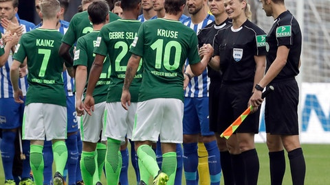 Referee Bibiana Steinhaus, 2nd right, shakes hand with players prior to the German Bundesliga soccer match between Hertha BSC Berlin and SV Werder Bremen in Berlin, Germany, Sunday, Sept. 10, 2017. (AP Photo/Michael Sohn)