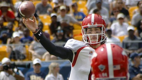 Youngstown State quarterback Hunter Wells (6) passes to tight end Shane Kuhn (86) in the first quarter of the NCAA football game against Pittsburgh, Saturday, Sept. 5, 2015,  in Pittsburgh. (AP Photo/Keith Srakocic)