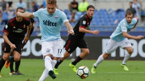 Lazio's Ciro Immobile scores on a penalty kick during a Serie A soccer match between Lazio and AC Milan, at the Rome Olympic stadium, Sunday, Sept. 10, 2017. (AP Photo/Alessandra Tarantino)