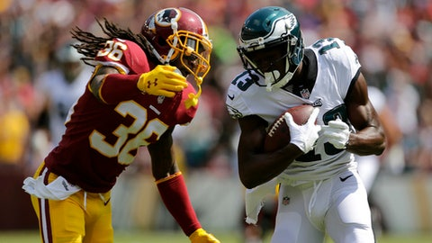 Philadelphia Eagles wide receiver Nelson Agholor, right, rushes past Washington Redskins free safety D.J. Swearinger for a touchdown in the first half of an NFL football game, Sunday, Sept. 10, 2017, in Landover, Md. (AP Photo/Mark Tenally)