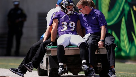 Baltimore Ravens running back Danny Woodhead (39) is carted off the field after an injury in the first half of an NFL football game against the Cincinnati Bengals, Sunday, Sept. 10, 2017, in Cincinnati. (AP Photo/Gary Landers)