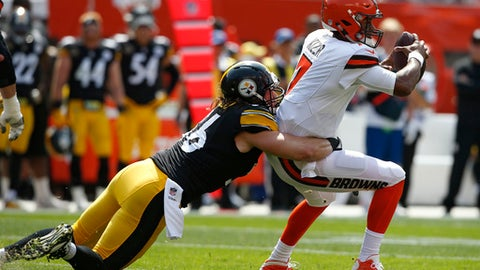 Cleveland Browns quarterback DeShone Kizer, right, is tackled by Pittsburgh Steelers outside linebacker Anthony Chickillo during the first half of an NFL football game, Sunday, Sept. 10, 2017, in Cleveland. (AP Photo/Ron Schwane)