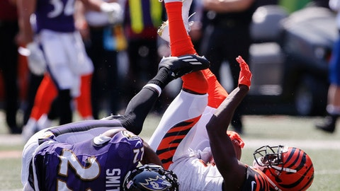 Baltimore Ravens cornerback Jimmy Smith (22) tackles Cincinnati Bengals wide receiver A.J. Green (18) in the first half of an NFL football game, Sunday, Sept. 10, 2017, in Cincinnati. (AP Photo/Gary Landers)