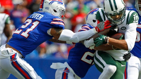 Buffalo Bills' Tre'Davious White, center, and Jordan Poyer, left, tackle New York Jets' Jermaine Kearse, right, during the first half of an NFL football game Sunday, Sept. 10, 2017, in Orchard Park, N.Y. (AP Photo/Jeffrey T. Barnes)