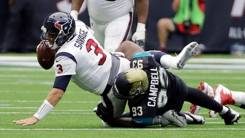 Houston Texans quarterback Tom Savage (3) is sacked by Jacksonville Jaguars defensive tackle Calais Campbell (93) during the first half of an NFL football game Sunday, Sept. 10, 2017, in Houston. (AP Photo/David J. Phillip)