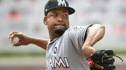 Miami Marlins' Odrisamer Despaigne pitches during the first inning of a baseball game against the Atlanta Braves, Sunday, Sept. 10, 2017, in Atlanta. (AP Photo/John Amis)