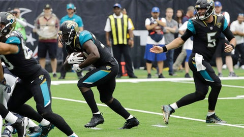 Jacksonville Jaguars running back Leonard Fournette (27) takes a handoff from quarterback Blake Bortles (5) to score a touchdown against the Houston Texans during the first half of an NFL football game Sunday, Sept. 10, 2017, in Houston. (AP Photo/David J. Phillip)