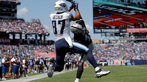 Oakland Raiders strong safety Karl Joseph (42) knocks a pass away from Tennessee Titans wide receiver Eric Decker (87) in the end zone during the first half of an NFL football game Sunday, Sept. 10, 2017, in Nashville, Tenn. (AP Photo/James Kenney)