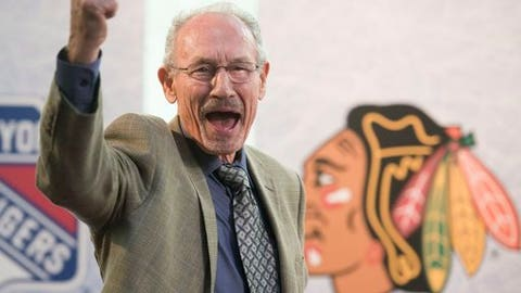 FILE - This Oct. 2, 2014 file photo shows Hall of Fame defenseman for the Chicago Blackhawks Pierre Pilote cheering during the unveiling of the NHL stamp series featuring defensemen from the original six NHL teams, at the Hockey Hall of Fame in Toronto. Pilote, a three-time Norris Trophy winner who helped the Blackhawks win the Stanley Cup in 1961, has died. He was 85. Pilote passed away Saturday, Sept. 9, 2017. (AP Photo/The Canadian Press, Hannah Yoon, file)