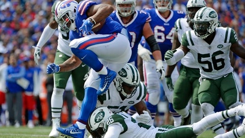 Buffalo Bills fullback Mike Tolbert (35) breaks a tackle by New York Jets' Marcus Maye (26) during the first half of an NFL football game, Sunday, Sept. 10, 2017, in Orchard Park, N.Y. (AP Photo/Adrian Kraus)