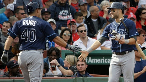 Tampa Bay Rays' Wilson Ramos, left, is welcomed home by Rays' Kevin Kiermaier, right, after Ramos hit a home run off a pitch by Boston Red Sox's Brandon Workman in the sixth inning of a baseball game, Sunday, Sept. 10, 2017, in Boston. (AP Photo/Steven Senne)