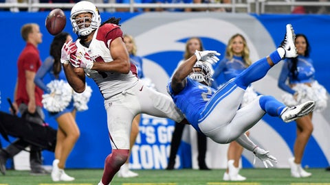 Arizona Cardinals wide receiver Larry Fitzgerald can't catch a pass as Detroit Lions cornerback Quandre Diggs defends during the fourth quarter of an NFL football game in Detroit Sunday Sept. 10 2017. Detroit won 35-23. (AP