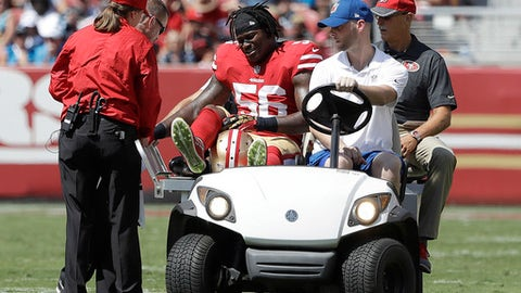 San Francisco 49ers linebacker Reuben Foster (56) is carted off the field during the first half of an NFL football game against the Carolina Panthers in Santa Clara, Calif., Sunday, Sept. 10, 2017. (AP Photo/Marcio Jose Sanchez)