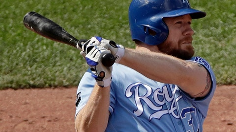 Kansas City Royals' Brandon Moss watches his three-run home run during the seventh inning of a baseball game against the Minnesota Twins, Sunday, Sept. 10, 2017, in Kansas City, Mo. (AP Photo/Charlie Riedel)