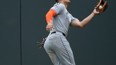 Miami Marlins right fielder Giancarlo Stanton catches a fly ball hit by Atlanta Braves' Matt Kemp to end the ninth inning of a baseball game, Sunday, Sept. 10, 2017, in Atlanta. (AP Photo/John Amis)