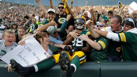 Green Bay Packers' Ty Montgomery celebrates his touchdown run with fans during the second half of an NFL football game against the Seattle Seahawks Sunday, Sept. 10, 2017, in Green Bay, Wis. (AP Photo/Mike Roemer)
