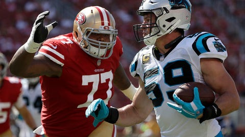 Carolina Panthers middle linebacker Luke Kuechly (59) returns an interception against San Francisco 49ers offensive tackle Trent Brown (77) during the second half of an NFL football game in Santa Clara, Calif., Sunday, Sept. 10, 2017. (AP Photo/Marcio Jose Sanchez)