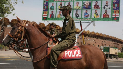Pakistani police officers patrol in the vicinity of Gaddafi Stadium ahead of the World XI cricket series, in Lahore, Pakistan, Monday, Sept. 11, 2017. The series is aimed at reviving international cricket in Pakistan, since terrorists attacked the Sri Lanka cricket team bus in Lahore in 2009. (AP Photo/K.M. Chaudary)