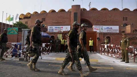 Pakistani paramilitary soldiers patrol in the vicinity of Gaddafi Stadium ahead of the World XI cricket series, in Lahore, Pakistan, Monday, Sept. 11, 2017. A World XI led by South Africa's Faf du Plessis arrived in Lahore early Monday amid tight security to play a three-match Twenty20 series against Pakistan. (AP Photo/K.M. Chaudary)