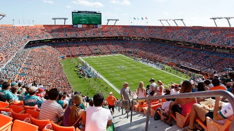 Fans walk to their seats during an NFL football game, Sunday, Jan. 1, 2012, in Miami against the New York Jets. The Dolphins won 19-17.  (AP Photo/J Pat Carter)