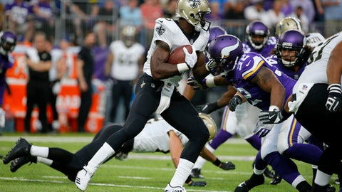 New Orleans Saints running back Adrian Peterson runs from Minnesota Vikings defensive tackle Tom Johnson (92) during the first half of an NFL football game, Monday, Sept. 11, 2017, in Minneapolis. (AP Photo/Bruce Kluckhohn)