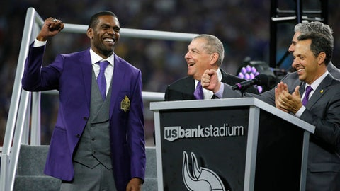 Former Minnesota Vikings wide receiver Randy Moss, left, reacts as he is inducted into the Vikings Ring of Honor during halftime of an NFL football game between the Vikings and the New Orleans Saints, Monday, Sept. 11, 2017, in Minneapolis. (AP Photo/Bruce Kluckhohn)