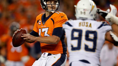 Denver Broncos quarterback Trevor Siemian (13) looks to throw as Los Angeles Chargers defensive end Joey Bosa (99) pursues during the first half of an NFL football game, Monday, Sept. 11, 2017, in Denver. (AP Photo/David Zalubowski)