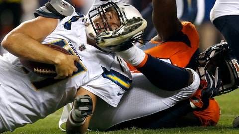 Los Angeles Chargers quarterback Philip Rivers is sacked by Denver Broncos outside linebacker Shaquil Barrett, right, during the second half of an NFL football game, Monday, Sept. 11, 2017, in Denver. (AP Photo/David Zalubowski)
