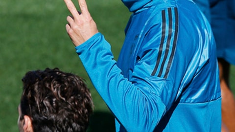 Real Madrid's Cristiano Ronaldo signals during a training session in Madrid, Spain, Tuesday, Sept. 12, 2017. Real Madrid will play APOEL Nikosia Wednesday in a Group H Champions League soccer match. (AP Photo/Paul White)