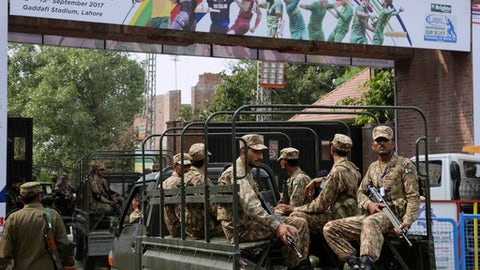 Pakistan army soldiers patrol near Gaddafi Stadium to ensure security ahead of the start of first Twenty20 cricket match between the World XI team and Pakistan, in Lahore, Pakistan, Tuesday, Sept. 12, 2017. The World XI team led by South Africa's Faf du Plessis arrived in Lahore amid tight security to play a three-match Twenty20 series against Pakistan. (AP Photo/K.M. Chaudary)