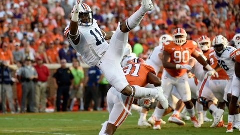 FILE - In this Sept. 9, 2017, file photo, Auburn wide receiver Kyle Davis (11) falls after failing to make a catch as Clemson cornerback Ryan Carter (31)defends during the first half of an NCAA college football game, in Clemson, S.C. No. 15 Auburn's offense is struggling even with a new coordinator and quarterback, especially in passing and protecting Jarrett Stidham. (AP Photo/Rainier Ehrhardt, File)