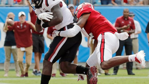 In this Sept. 2, 2017, photo South Carolina's Deebo Samuel runs for a touchdown against North Carolina State during the second half of an NCAA football game in Charlotte, N.C. If the Gamecocks are going to surprise in the Southeastern Conference, it will likely be the dynamic, versatile Samuel who'll make it happen. (AP Photo/Bob Leverone)
