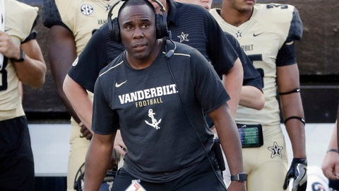 FILE - In this Sept. 9, 2017, file photo, Vanderbilt head coach Derek Mason watches the action from the sideline in the second half of an NCAA college football game against Alabama A&M, in Nashville, Tenn. Vanderbilt's first 2-0 start under coach Derek Mason is about to be tested. And how. The Commodores host 18th-ranked Kansas State on Saturday night, the first of four straight games against Top 25 opponents. (AP Photo/Mark Humphrey, File)