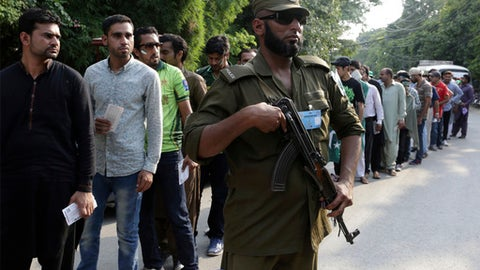A Pakistani security personnel stands guard outside the Gaddafi Stadium ahead of the start of the first Twenty20 cricket match between the World XI team and Pakistan, in Lahore, Pakistan, Tuesday, Sept. 12, 2017. The World XI team led by South Africa's Faf du Plessis arrived in Lahore amid tight security to play a three-match Twenty20 series against Pakistan. (AP Photo/K.M. Chaudary)