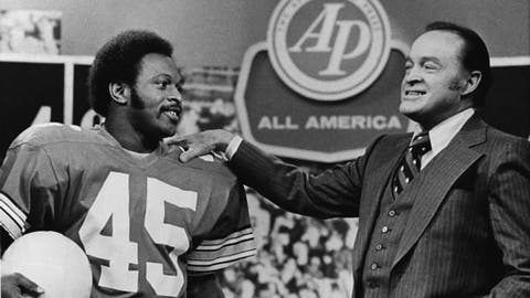 FILE - In this Dec. 8, 1975, file photo, comedian Bob Hope, right, talks with Ohio State All-America football player and Heisman Trophy winner Archie Griffin during taping of Hope's Christmas program in New York. For many college football fans of a certain age, their introduction to The Associated Press All-America team came during Bob Hope's annual TV Christmas special. (AP Photo/File)