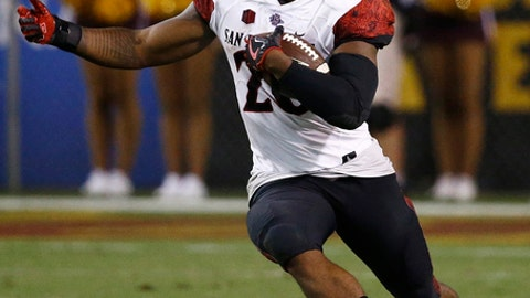 FILE - In this Sept. 9, 2017, file photo, San Diego State's Rashaad Penny runs against Arizona State during the second half of an NCAA college football game, in Tempe, Ariz.  Penny leads the nation in all-purpose yards at 284 per game and will get a chance to take down another Pac-12 team on Saturday when No.  19 Stanford comes to San Diego.(AP Photo/Ross D. Franklin, File)