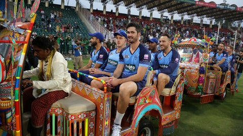 Members of the World XI team ride in traditional rickshaws before the start of the first Twenty20 cricket match between the World XI team and Pakistan, in Lahore, Pakistan, Tuesday, Sept. 12, 2017. The World XI team, led by South Africa's Faf du Plessis, arrived in Lahore amid tight security to play a three-match Twenty20 series against Pakistan. (AP Photo/K.M. Chaudary)