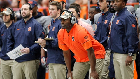 FILE - In this Nov. 12, 2016, file photo, Syracuse head coach Dino Babers, center, watches a play from the Syracuse sideline in the third quarter of an NCAA college football game against North Carolina State, in Syracuse, N.Y. Two games into his second season at Syracuse, coach Dino Babers remains a patient man, even with a daunting schedule looming. (AP Photo/Nick Lisi, File)