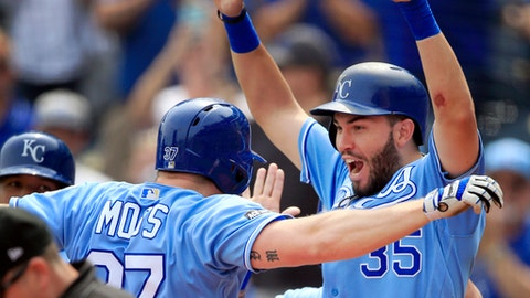 Kansas City Royals' Brandon Moss (37) celebrates his grand slam with teammate Eric Hosmer (35) during the first inning of a baseball game against the Chicago White Sox at Kauffman Stadium in Kansas City, Mo., Tuesday, Sept. 12, 2017. (AP Photo/Orlin Wagner)