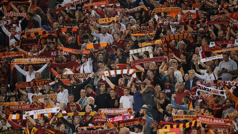 Roma fans chant at the start of a Champions League, Group C match, between Roma and Atletico Madrid, at the Olympic stadium in Rome, Tuesday, Sept. 12, 2017. (AP Photo/Alessandra Tarantino)