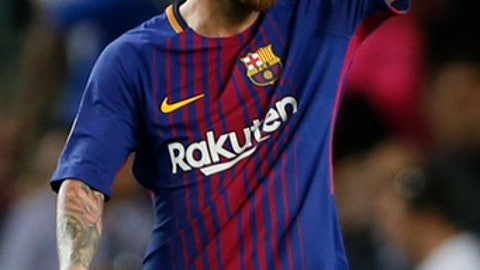 Barcelona's Lionel Messi celebrates after scoring his side's third goal during a Champions League group D soccer match between FC Barcelona and Juventus at the Camp Nou stadium in Barcelona, Spain, Tuesday, Sept. 12, 2017. (AP Photo/Francisco Seco)